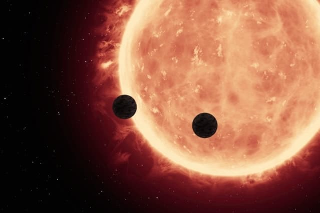 20160721084027-an-artists-depiction-of-planets-transiting-a-red-dwarf-star-in-the-trappist-1-system.jpeg